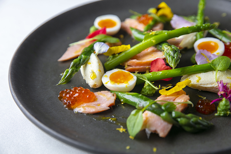 Hot smoked salmon and asparagus salad, quail eggs & horseradish