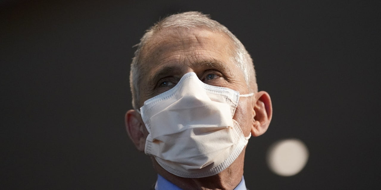 Dr. Fauci Says It's 'Possible' That We'll Need to Wear Masks Into 2022